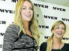 Jennifer Hawkins (left) with number one fan Alisha Thompson in Toowoomba yesterday.