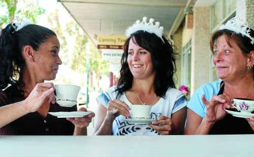 Customer Bree Field (centre) shares a cuppa with Belle Vue cafe employers Joanna Budd and Melody Marsh on the day of the royal wedding.