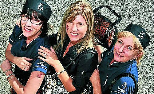 Tracy Perryer , Fiona Vecchio and Lissa Holgate show off some bags.