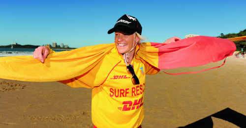 Volunteer lifesaver Rachel Dickinson takes down the flags at Mooloolaba. From tomorrow, beaches will be patrolled by council-paid lifeguards.