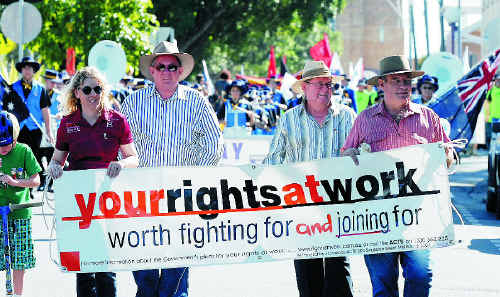 Terese Kingston, Member for Mackay Tim Mulherin, Cr Kevin Casey and QCU Mackay branch president Greg Thomsen take part in the Labour Day march.