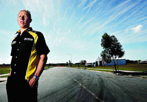 Rally driver Alister McRae checks out the circuit ahead of last year's racing at the Caloundra industrial estate.