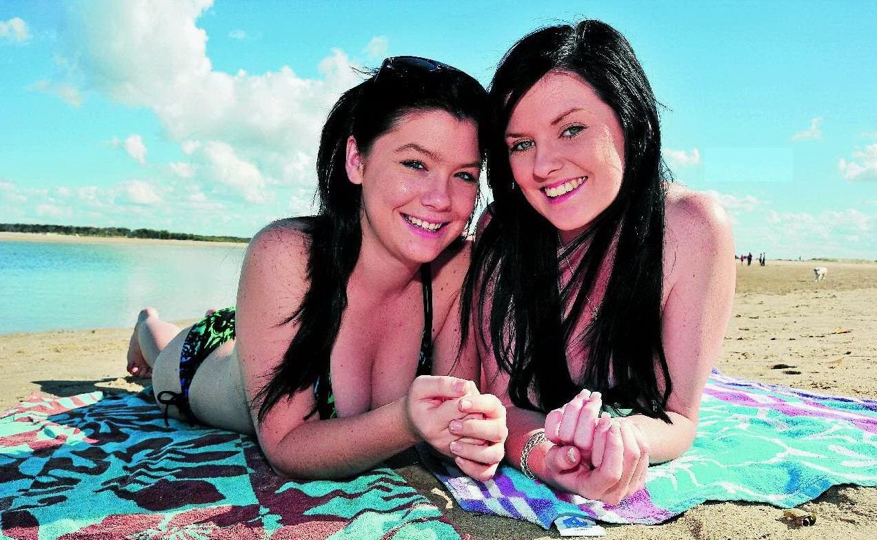 Bronte Webb and Stef Fusche enjoy the public holiday down at Elliott Heads Beach as hundreds headed to the coast. And forecasters predict our ideal weather will continue.