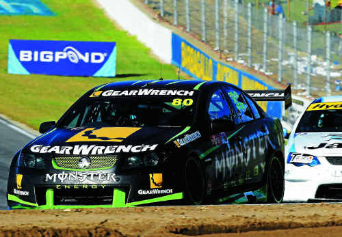 Former Byron Bay driver Andrew Thompson pulls away from David Russell in the 2011 Fujitsu V8 Supercar Series at Barbagallo Raceway in Perth last weekend.