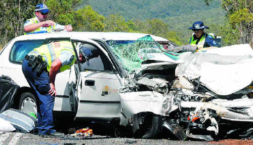 The wreckage of the vehicle in which a young German tourist was fatally injured on Monday in a two-car collision on the Bruce Highway. Three others are in hospital. The crash closed the highway for seven hours.