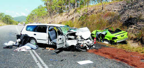 The crash scene after the fatal collision near Carmila, south of Mackay, on Monday.