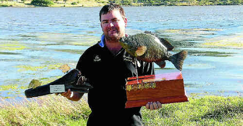Dave Creffield of Collinsville is the new world sooty grunter champion after the weekend's championship at Eungella Dam.