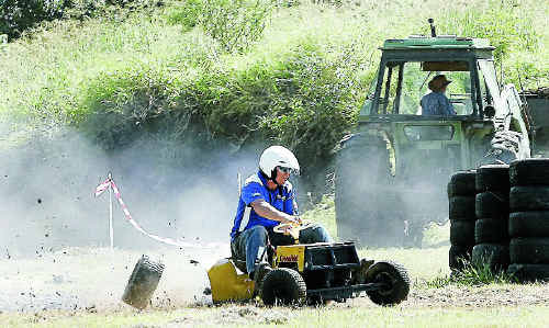 Craig Shuker on Yeppoon Small Motors' Pig Dog loses a wheel during a warm-up at The Caves Agricultural Show 2011.