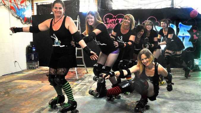 Derby Dolls from front: CC Quick-Kill, Mystic Rebellion, Rika Havoc, Joann Hackney, London Brawling, Pina Collison and Jaymi-Lee Austin.