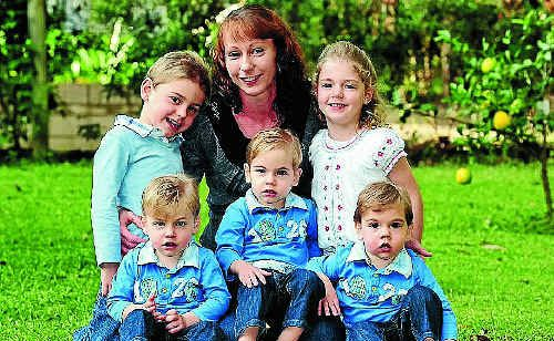 Kylie Vieritz with five-year-old twins James and Emilie and two-year-old triplets (from left) Connor, Aiden and Riley.