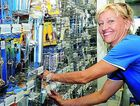Ingrid Gorissen busily prepares the retail shelves for the grand opening of Mitre 10 today.