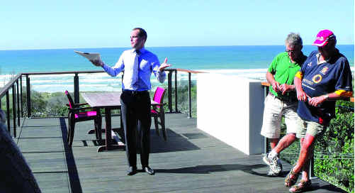 Auctioneer Jason Andrew invites bidding at 8 Egret Street, Peregian Beach, last Sunday.