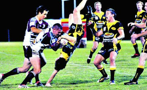 Jake Carle is on the receiving end of a controversial tackle during the match between Kawana and Caboolture at Stockland Park.