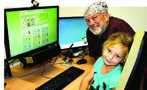 Associate Professor Mike Horsley with Azalia Frisby, one of the first students to use the eye tracker which could revolutionise the way we approach the production of learning materials in classrooms.