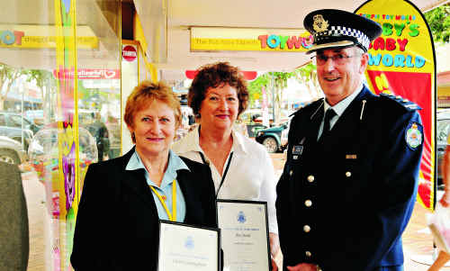 Inspector Steve Maney officially thanks police volunteers Carol Cunningham and Jan Stead, whose behind-the-scenes work allows more police to do their real job, protecting the community.