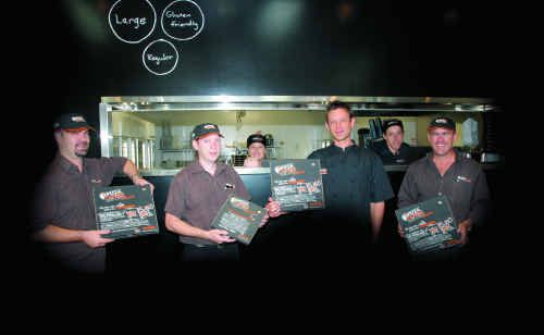Staff at the new gourmet pizza store Pizza Capers on Wood Street, Mackay are , from left, Ben Old (owner), Phil Reymers (manager), Dani Baronet (back), Dion Scholz (owner), Saul Townsend (back) and Anthony Old (owner).
