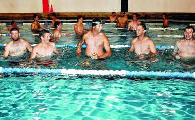 Personal instructor Luke Goodale, left, takes Whitsunday Miners players, from left, Brad Moss, Matthew Zappone, Troy Mundy, Aaron Craig and Jamie White through a pool session.