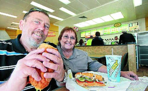 Ken and Jen Huggins tuck into a Subway sub in support of their favourite takeaway.