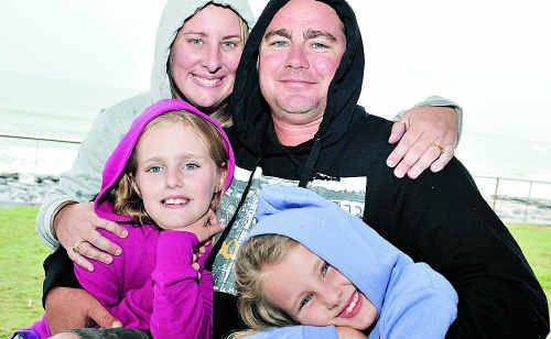 Clint Smith, Renee Smith, Rhiannon, 10, and Imogen, 7, felt the winter chills on the Sunshine Coast yesterday.