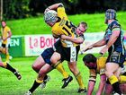 Caloundra player Trent Prygoda is held up by Noosa Pirates' defence at Pirate Park.