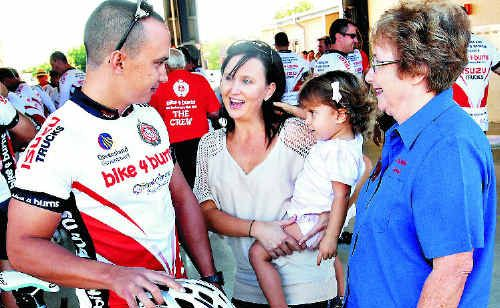 Rob Noy, of Mackay, says goodbye to his sister Julie Newton, niece Summer and mother Carmel Noy before leaving on the Bike 4 Burns charity ride.