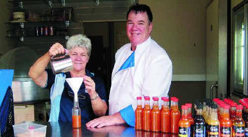 Sarina Sugar Shed volunteer Lorraine Hodgkinson helps chef John Walker.