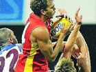 Gold Coast Suns player Nathan Krakouer (centre) takes a high mark against the Brisbane Lions on Saturday.