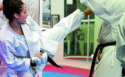 Black belt Emily Dunn trains with coach Lutie van den Berg.