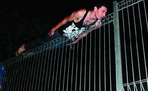 Aaron Monaghan performs a daring plank stunt.