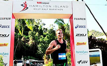 THE WINNER: Rob Matthews from Hamilton Island crossing the line in first place in the fifth Westpac Hilly Half Marathon on May 1.