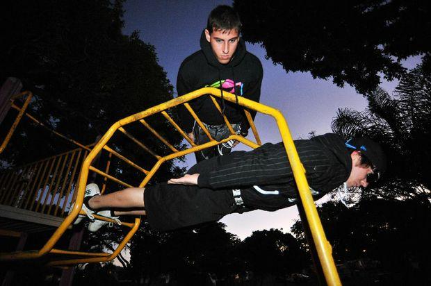 Josh Wolff and Jason Rozycki taking a plank at Alexandra Park in Bundaberg.
