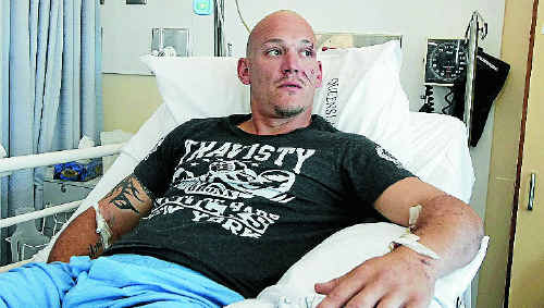 Central Comets star and proud father-of-two Alan Rothery recovering at Rockhampton Hospital yesterday after Thursday's truck rollover. He is determined to make it back on the field as early as next week.