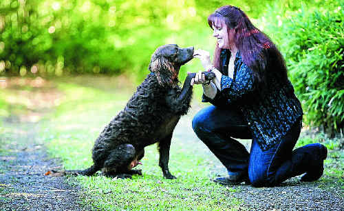 Animal psychic Heidi Wright with Australian Murray River curly coated retriever, Mahoney.