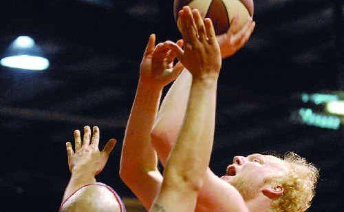 Meteors player Michael Kingma makes a shot over Rockhampton import Travis Reed