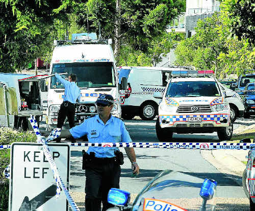 THIN BLUE LINE: Police cordon off the area where the bodies were found. Photos: Scott Powick TWE160511police9