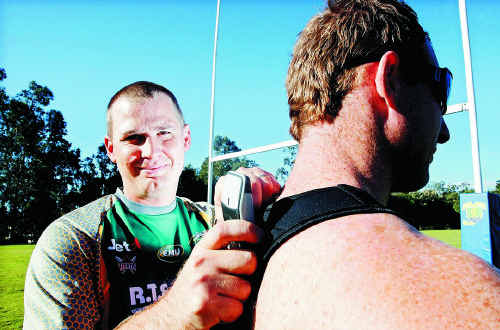 Ipswich Jets and new State of Origin trainer Matt Barradeen works with former Jets player Andy Poynter using state of the art GPS equipment.