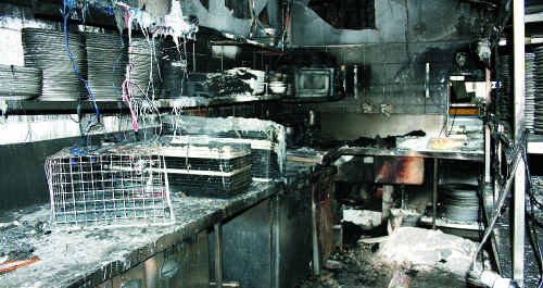 The gutted shell of the kitchen at popular Airlie Beach restaurant Fish D'Vine, on Shute Harbour Road, after a devastating fire early yesterday. The restaurant is expected to be out of action for a few months.