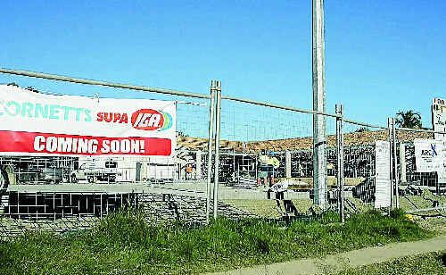Workers on the construction site of the Supa IGA in Dean St which is due to open for business by August.