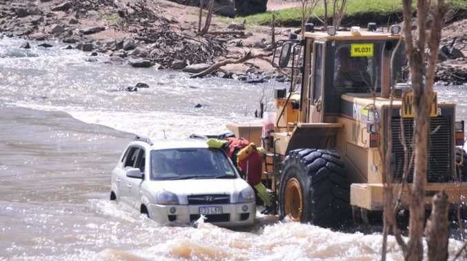 A front end loader was used to rescue a woman from her car from the causeway crossing at the Bedford Weir.