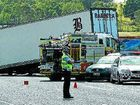Police divert traffic around the semi-trailer accident on the Bruce Hwy at Apple Tree Creek.