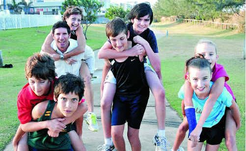 Mackay runners looking forward to the Marina Run on June 5 include, from left, Donavan Rath carrying Codey Rath, Alan Zamparutti, back, with Janelle Tilse, Brayden Rath with Cooper Rath and Samantha Banks with Jasmine Banks.