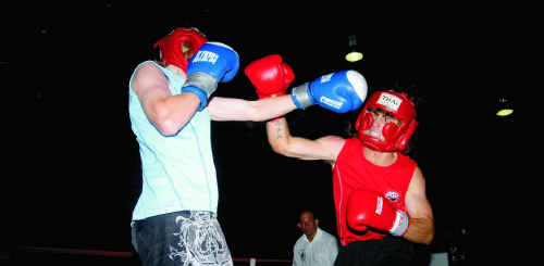 Ben Martland and Darcy Norton do battle at a past PCYC's Fast and Furious Fight Night.
