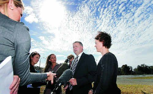 Federal Transport Minister Anthony Albanese and Member for Capricornia Kirsten Livermore face the media near the Yeppen roundabout yesterday.