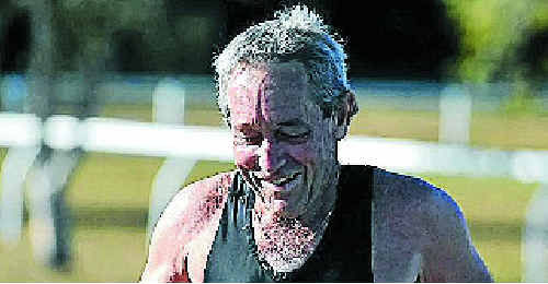 FIRST HOME: Richard Crofton was the first to cross the finish line at the Clarence Valley Triathlon Club race on Sunday morning which started and finished at the Yamba Heated Pool. Photo: JoJo Newby