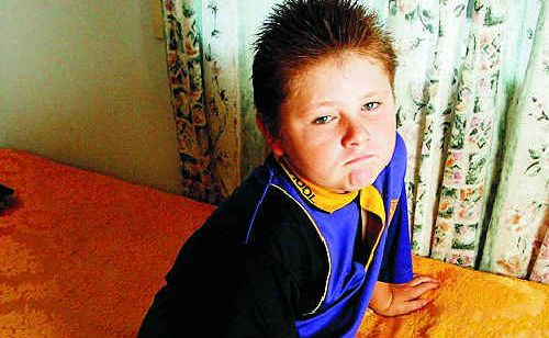 David Kay, 9, still suffers stress after being attacked by a police dog that entered the family home in Goodna last September.