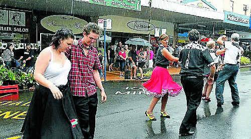 RAIN DANCE: Locals celebrate.