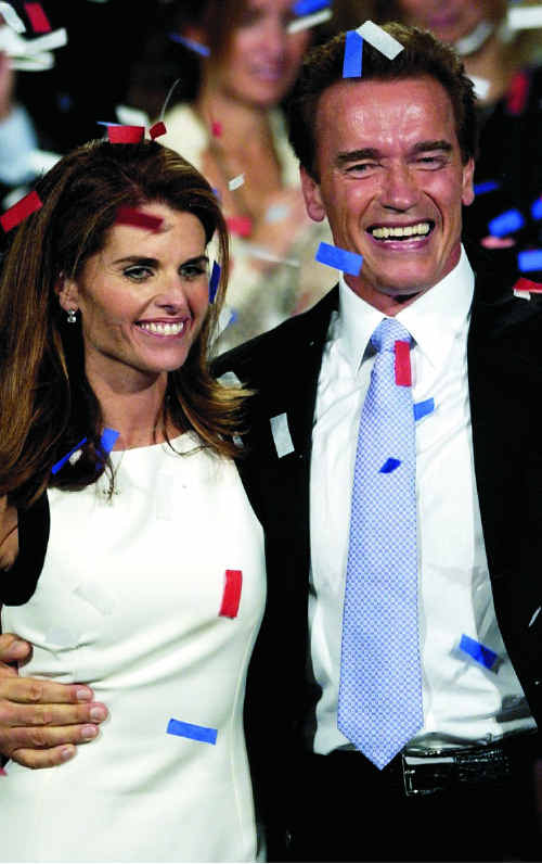 Arnold Schwarzenegger and his wife, Maria Shriver, celebrate his victory in the California governor election.