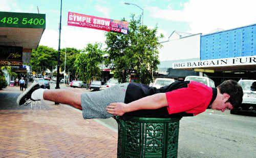 Nick Powell planking on a rubbish bin in Mary Street Gympie Renee Pilcher.