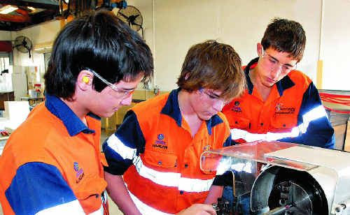 At Mackay Engineering College, learning the ins and outs of the industry are, from left, Logan McGrath, Harlan De Haas and Conor Bryant.
