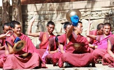 Monks perform a skilful musical performance.